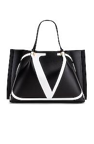 VALENTINO | Valentino V Logo Escape Medium Tote in Black,White | Goxip