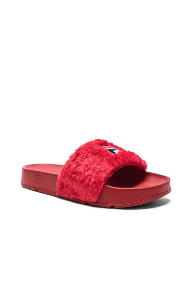 Baja East x Fila Faux Shearling Slides in Red