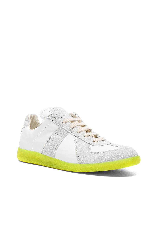 Photo of Maison Margiela Leather Replica Sneakers in White,Neon - shop Maison Margiela menswear