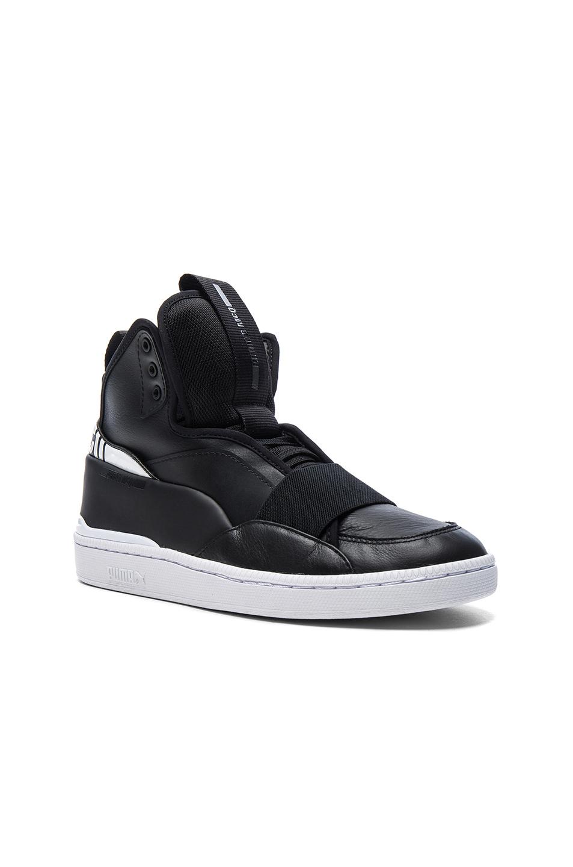 Photo of Puma Select x McQ Brace Mid in Black - shop Puma Select menswear