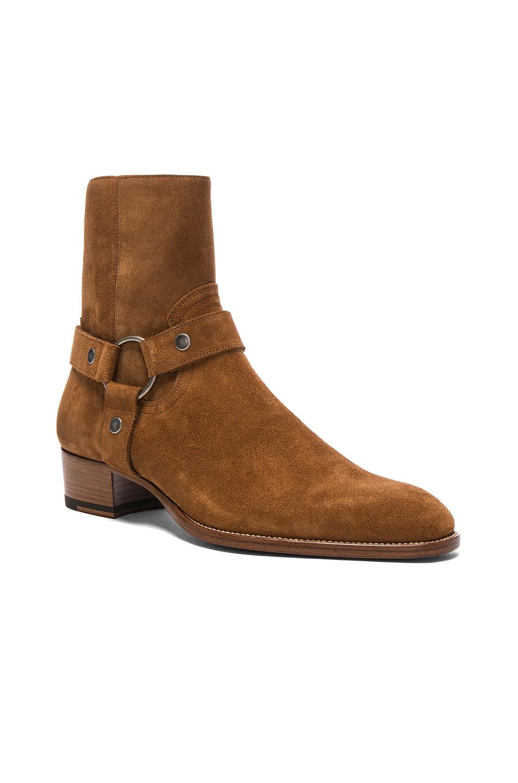 Photo of Saint Laurent Wyatt Suede Harness Boots in Brown - shop Saint Laurent menswear
