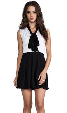 Alice + Olivia Kimmy Sleeveless Tie Neck Romper in Black