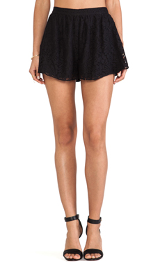 BCBGeneration Side Ruffle Hem Shorts in Black