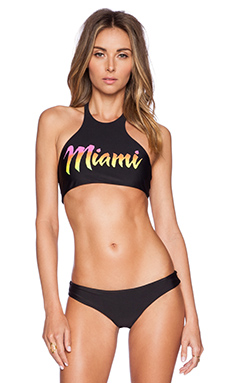 BEACH RIOT Salsa Bikini Top in Miami