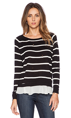 Central Park West New Orleans Distressed Ruffle Hem Sweater in Black & White