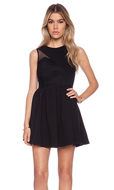 Donna Mizani Splice Flounce Dress in Black
