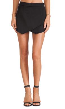 krisa Asymmetrical Mini Skirt in Black