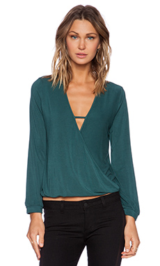 krisa Long Sleeve Surplice Top in Lagoon