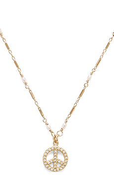 Natalie B Jewelry Peace Pave Charm Necklace in Gold