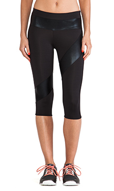 Active by Norma Kamali Spliced Diagonal Capri Legging in Black & Black Foil