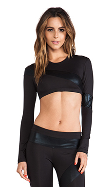 Active by Norma Kamali Spliced Long Sleeve Crop Top in Black & Black Foil