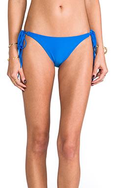 Sofia by Vix Swimwear Long Tie Side Fringe Bottom in Solid Dark Blue