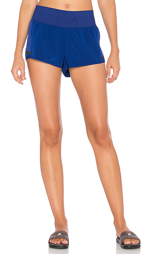 Photo of adidas by Stella McCartney Train Hiit Short in Blue - shop adidas by Stella McCartney tops sales