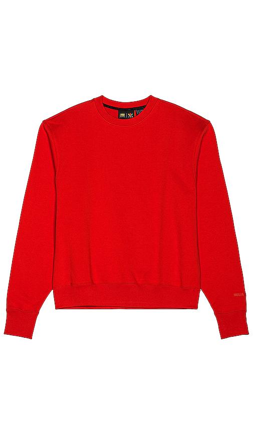 adidas x Pharrell Williams クルーネックスウェットシャツ in Red.