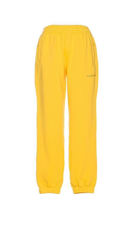 adidas x Pharrell Williams スウェットパンツ in Yellow.