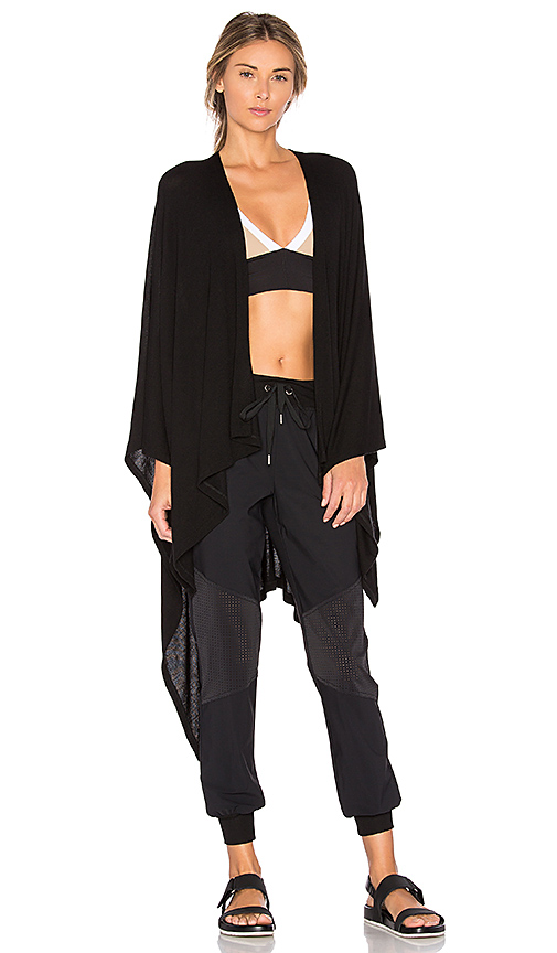 Beyond Yoga Open All Night Poncho in Black.