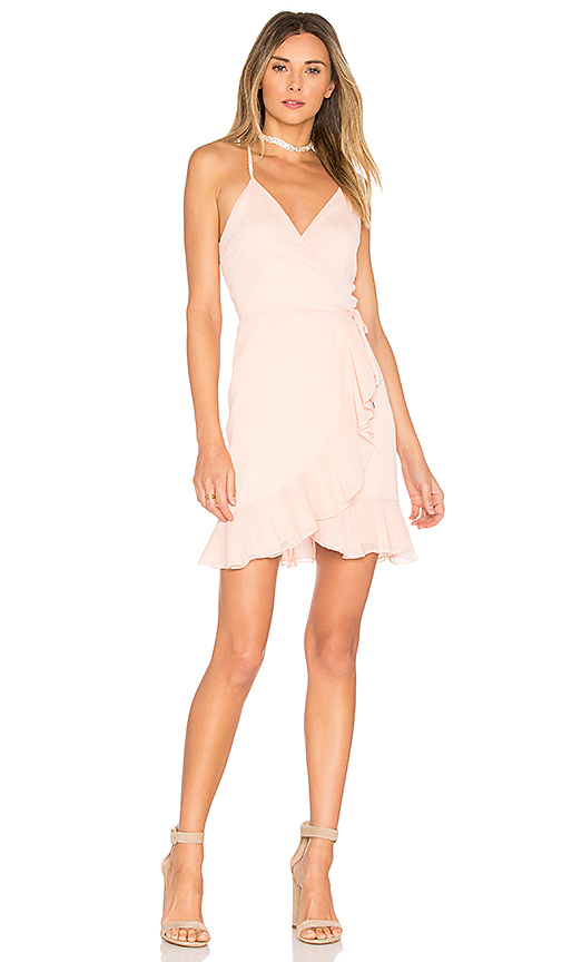 Lovers + Friends x REVOLVE Gigi Wrap Dress in Blush. - size L (also in M,S,XL, XS)