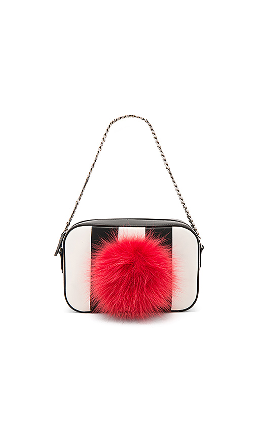 les petits joueurs Roy Bunny Bag with Fur Pom in Black & White.