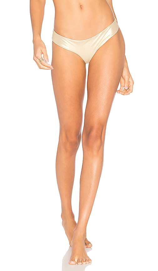 Luli Fama Buns Out Bikini Bottom in Metallic Gold