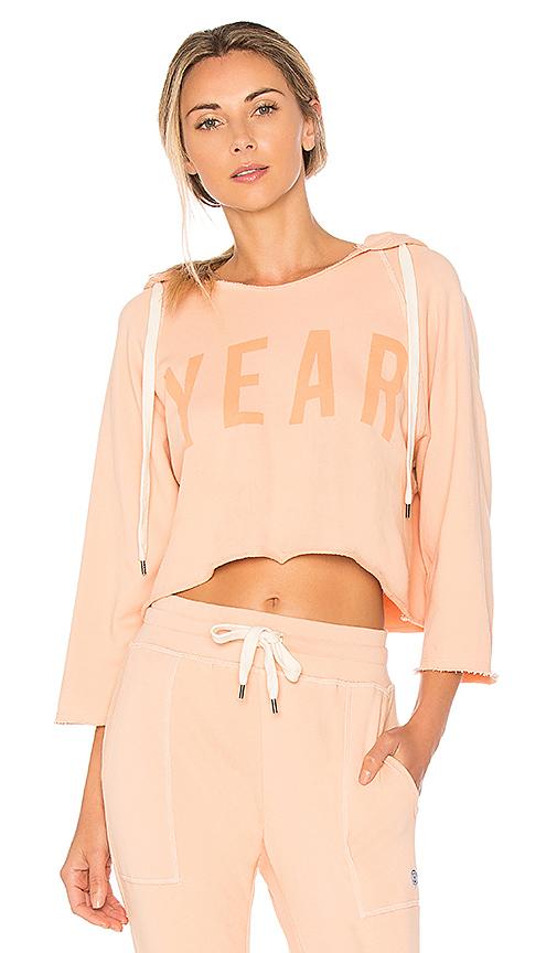 YEAR OF OURS Cropped YEAR Hoodie in Peach. - size L (also in M,S,XS)