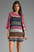 Image 1 of Indah Atlas Mix Knit Fringe Sleeve Mini Dress in Earth
