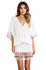 Image 1 of Indah Bayan Smocked Kaftan Mini Dress in White Endek