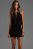 Image 1 of Indah Canoa Blouson Cut Away Smocked Mini Dress in Black