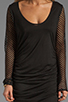 Image 5 of Riller & Fount Tyra Long Sleeve Shirred Mini with Fishnet Sleeves in Black