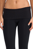 Image 4 of SOLOW Eclon Legging with Footholes & Fold Over Waistband in Black