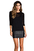 Image 1 of Tylie Leather Hem Knit Dress in Black