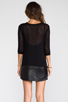Image 4 of Tylie Leather Hem Knit Dress in Black