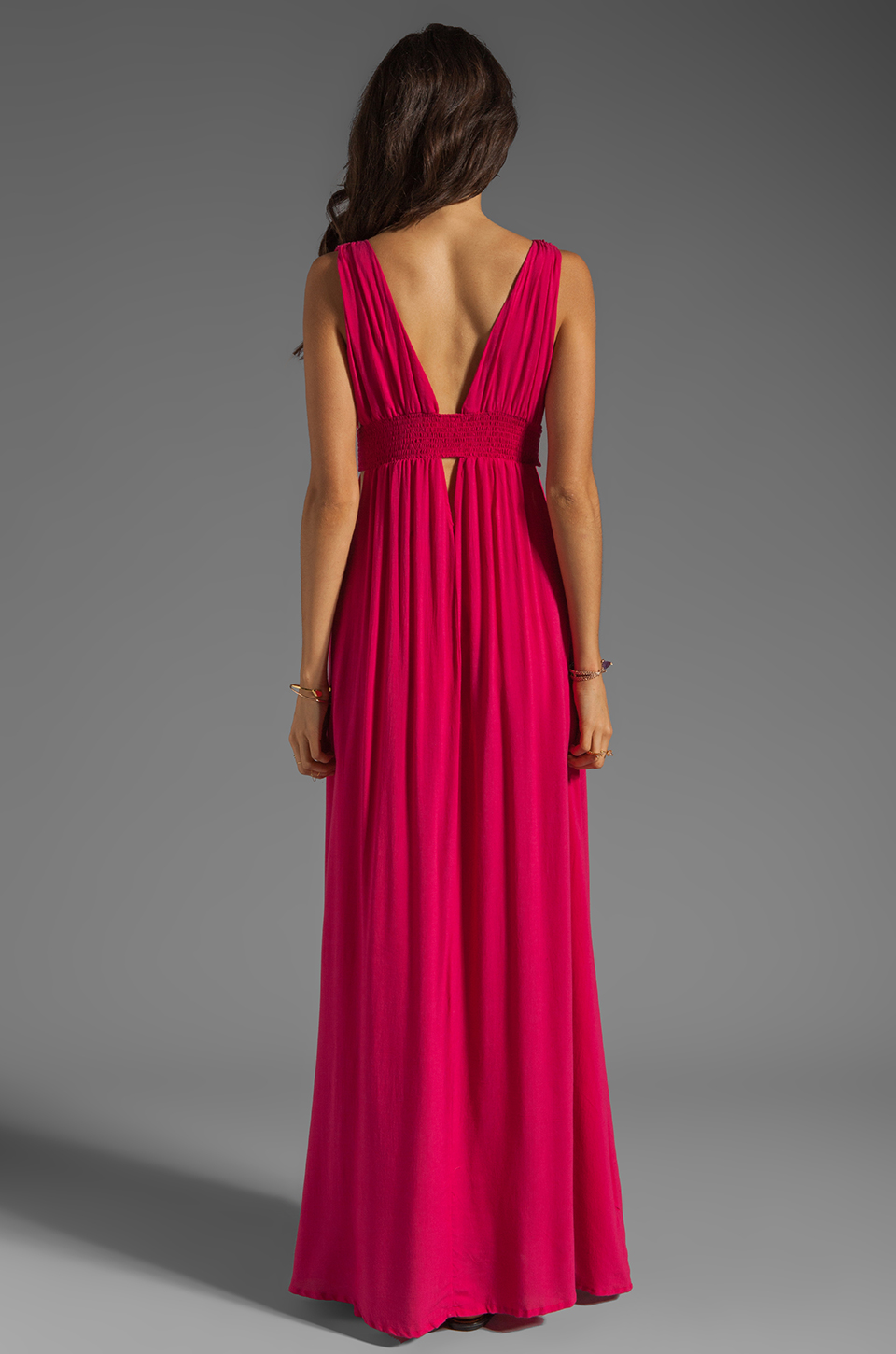 Indah Anjeli Rayon Crepe Plunging V-Nevk and V-Back Empire Maxi Dress in Hot Pink