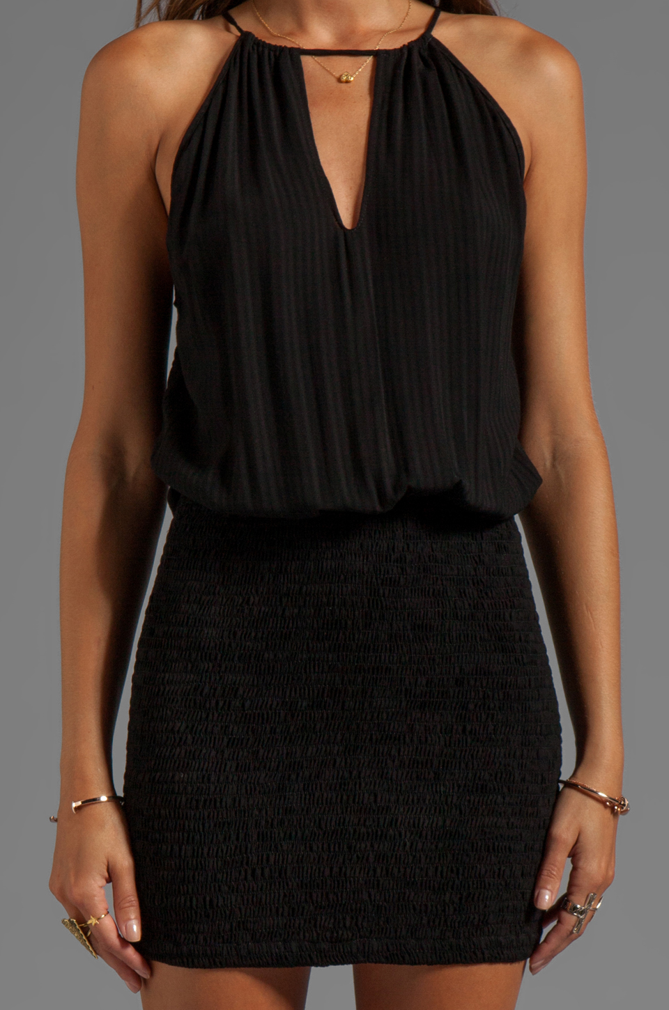 Indah Canoa Blouson Cut Away Smocked Mini Dress in Black
