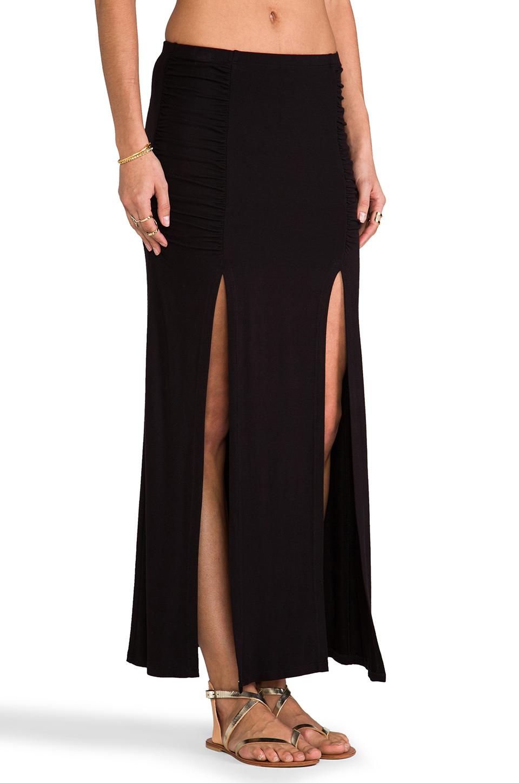 tylie front slit maxi skirt in black revolve